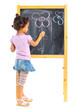 Little mulatto girl draws on the board