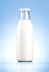 Bottle of fresh milk isolated on a blue background