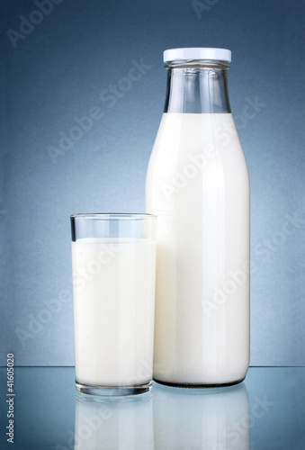 Bottle of fresh milk and a glass isolated on a dark grey backgro