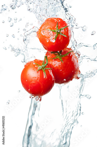 Staande foto Opspattend water Three Fresh red Tomatoes in splash of water Isolated on white ba