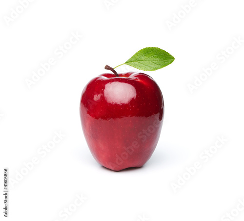 Red fresh apple with green leaf isolated on white background
