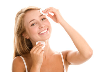 Woman removing makeup with cleansing pads