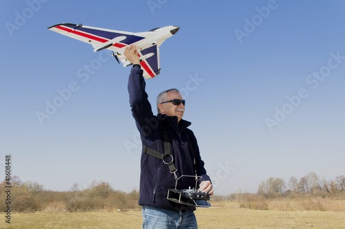RC modeller preparing for launch new remote controlled  plane