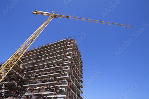 construction site with tower crane - cantiere, gru, cielo blu