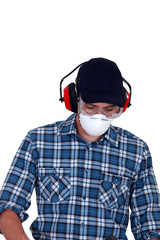 craftsman wearing protection mask, earphones and glasses