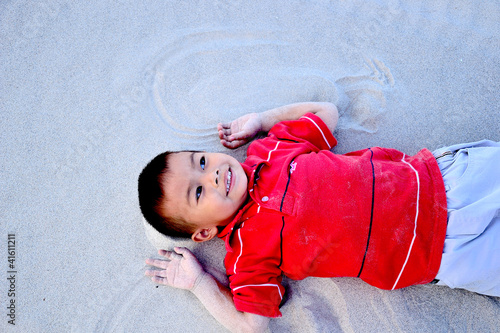 the boy relax on the beach