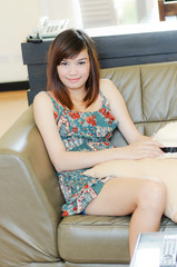Attrative Asian woman relaxing in living room