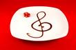 Chiave di violino con aceto balsamico, fragole, musica in cucina