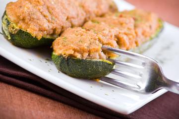 Stuffed zucchini halves.