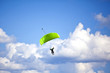 Skydiver with a green parachute