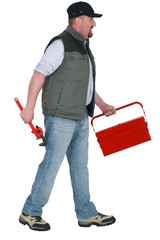 A manual worker with a toolbox.