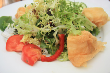 salad with fried goat cheese and tomato