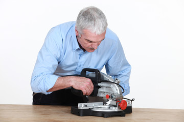 Man figuring out how to operate his new mitre saw