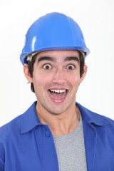 portrait of young tradesman playing the fool