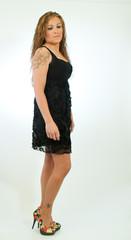 Model Standing Sideways In Black Dress