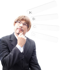 Portrait of a Businessman   thinking how to choosing A,B,C,D