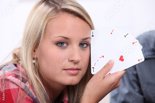 Girl showing poker cards
