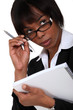 Afro-American businesswoman holding a notepad