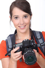Young brunette holding expensive camera