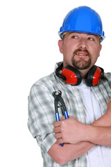 Tradesman holding a pair of pliers