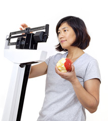 Woman with Apple on Scale Worried About Weight