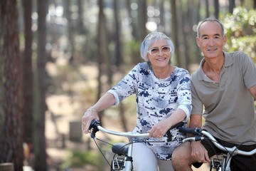 A mature couple on a bike ride.