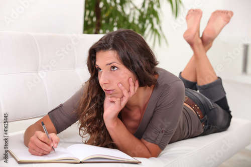 Woman writing in her diary