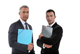 A team of businessmen holding folders