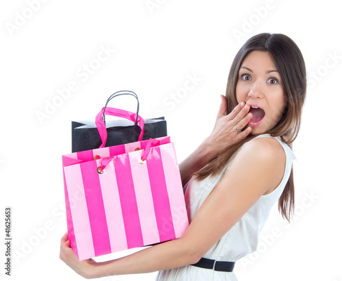 young woman with shopping bags after successful shoppingand look