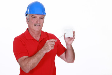 Electrician with wall socket