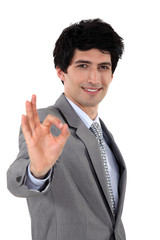 handsome businessman all smiles making okay sign