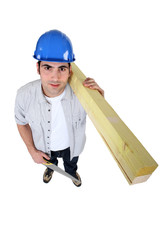 Man with timber and a saw