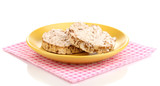 Bread snacks on saucer with napkin isolated on white
