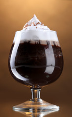 glass of coffee cocktail on brown background