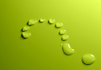Water drops question mark on green background