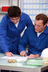 blue collars in office: apprentice and instructor