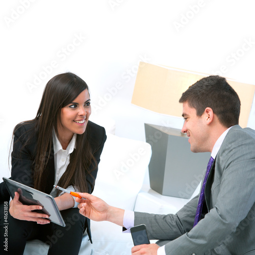 Business couple at meeting with tablet.