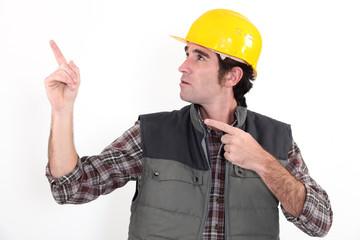 Tradesman pointing upwards