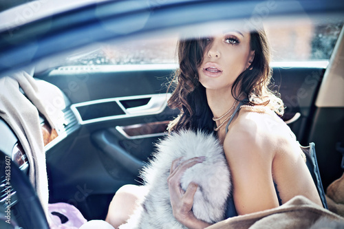 Adorable brunette in a car