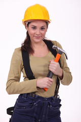 female laborer holding hammer