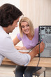 Computer technician helping woman