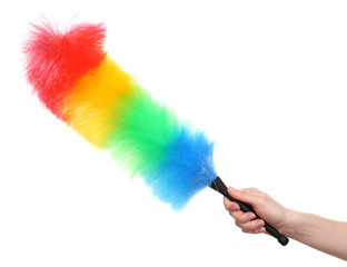 Soft colorful duster in hand on white