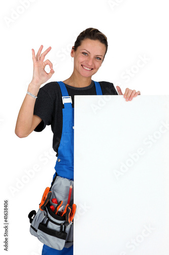 construction worker with tool belt and a board for your message