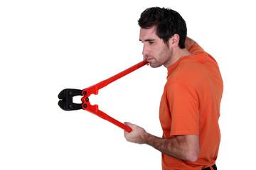 Man holding bolt-cutters