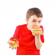 Boy eating a hamburger.