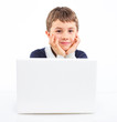 Young boy using notebook computer