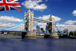 Tower Bridge with flag of England in London