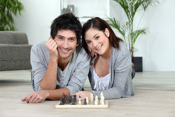 relaxed couple playing chess