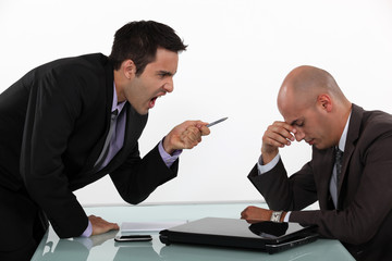 Businessman screaming at a colleague