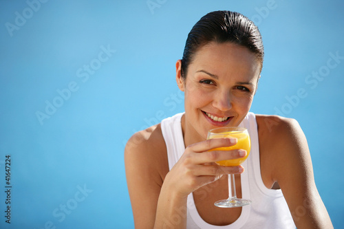 Healthy woman drinking orange juice